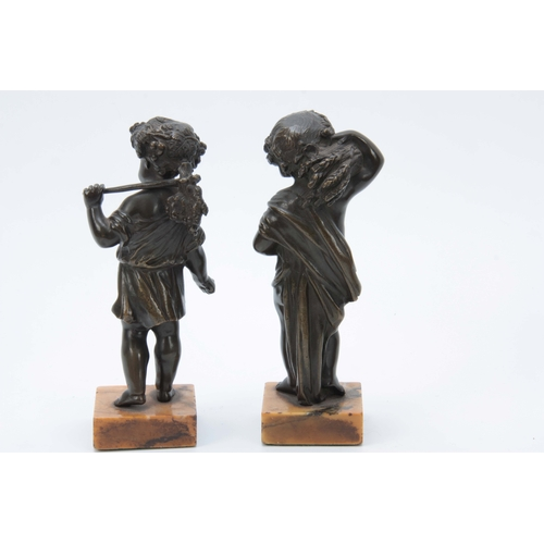 640 - A PAIR OF 19th CENTURY PATINATED BRONZE SCULPTURES modelled as putti harvesters mounted on Sienna ma...