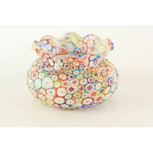 11 - AN ITALIAN MILLEFIORI GLASS VASE of squat bulbous form with crimped rim 9cm high, 15cm diameter