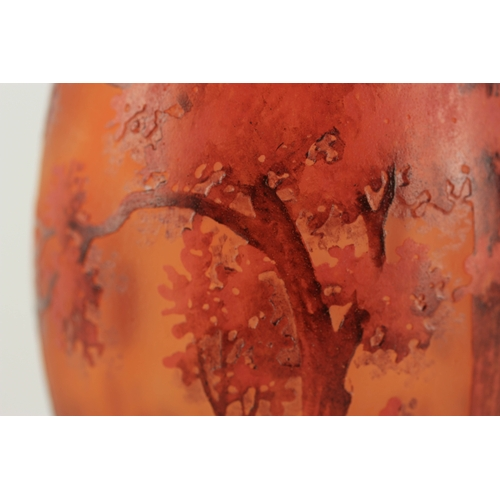 18 - DAUM, NANCY  AN EARLY 20TH CENTURY 'PAYSAGE LACUSTRE' CAMEO GLASS VASE showing an evening river land...