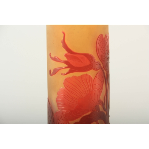 19 - A LARGE GALLE TALL SLENDER CYLINDRICAL GLASS VASE with a flattened bulbous base, overlaid with a mar...