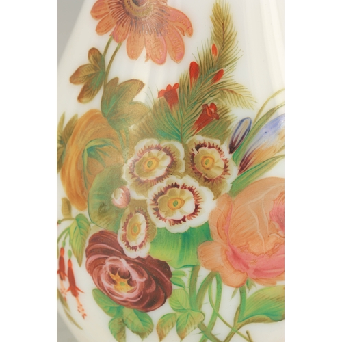 21 - A 20TH CENTURY BACCARAT STYLE OPALINE GLASS VASE with floral decoration, having gilt bands to the ri...