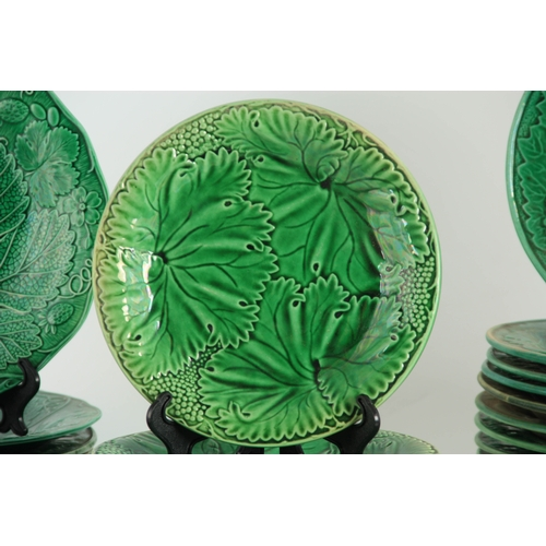31 - A LARGE COLLECTION OF 19TH CENTURY WEDGWOOD TYPE GREEN RELIEF MOULDED  PLATES of varying size with l...