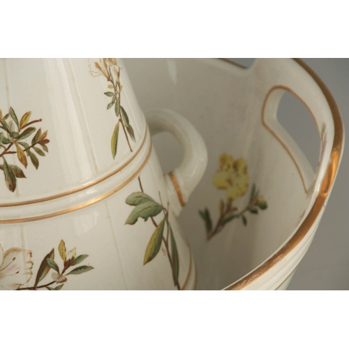 32 - A STYLISH LATE 19TH CENTURY GEORGE JONES TOILET SERVICE comprising two-handled washbowl and jug, lid...