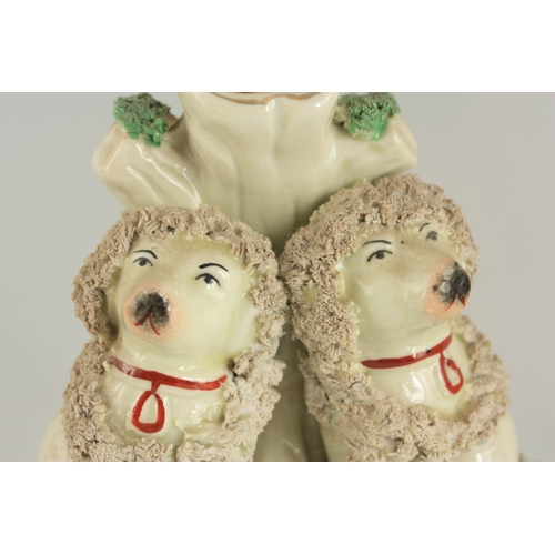 36 - A PAIR OF STAFFORDSHIRE SPILL VASES each modelled as seated poodles dressed in encrusted head and ne...
