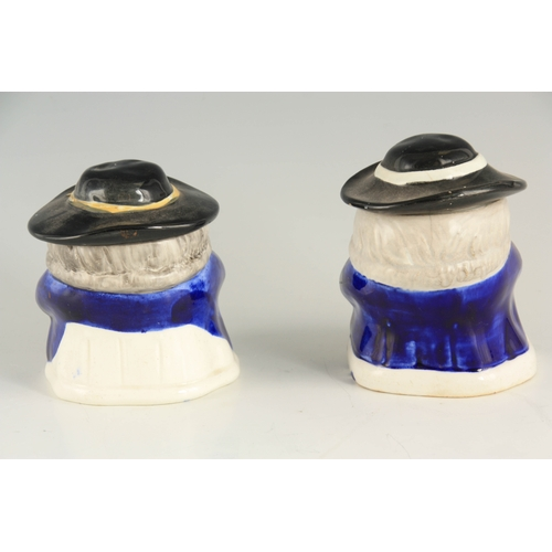 38 - A PAIR OF COLOURFUL SEATED TOBY FIGURE LIDDED JARS 12.5cm high