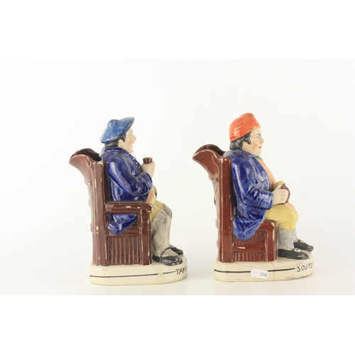 39 - A PAIR OF COLOURFUL SEATED STAFFORDSHIRE TOBY JUGS depicting 'Tam o Shanter' and 'Souter Johnny' eac...