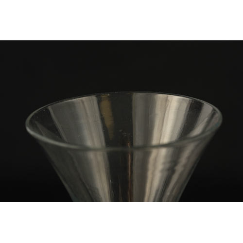 4 - A GEORGIAN PLAIN CLEAR WINE GLASS with flared bowl and teardrop tapering stem on a slightly domed fo...