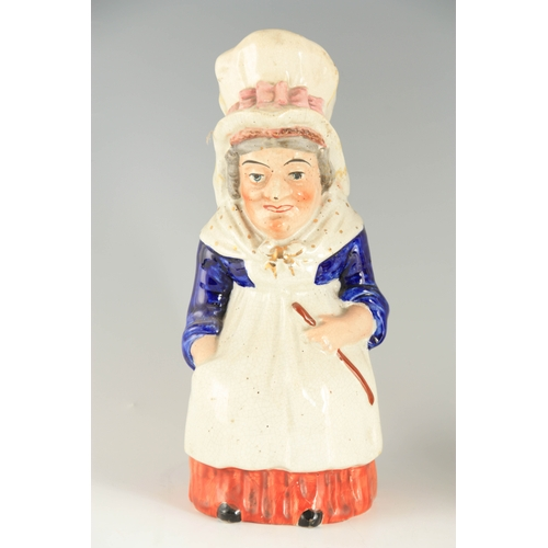 41 - AN OVERSIZED STAFFORDSHIRE STANDING FIGURE OF A SNUFF TAKER the well dressed portly figure wearing a...