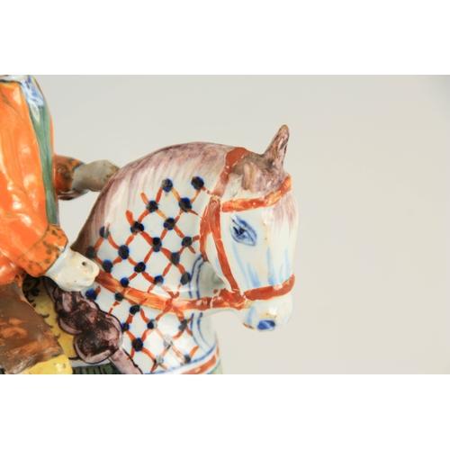 43 - AN 18TH/19TH CENTURY DUTCH DELFT POLYCHROME FIGURE depicting William of Orange on horseback 15.5cm h...