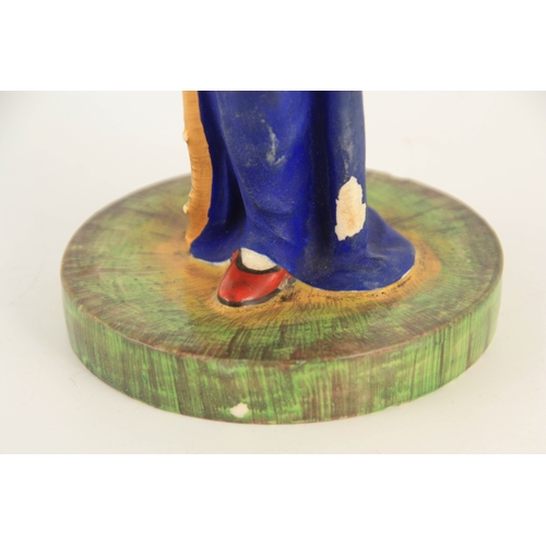45 - A RUSSIAN PORCELAIN FIGURE depicting a young female carrying baskets mounted on a circular base 23cm...