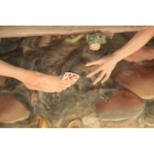 """47 - A NAPLES CAPODIMONTE LARGE OVAL FIGURE GROUP """"The young card players"""" signed to base 56.5cm wide acr..."""