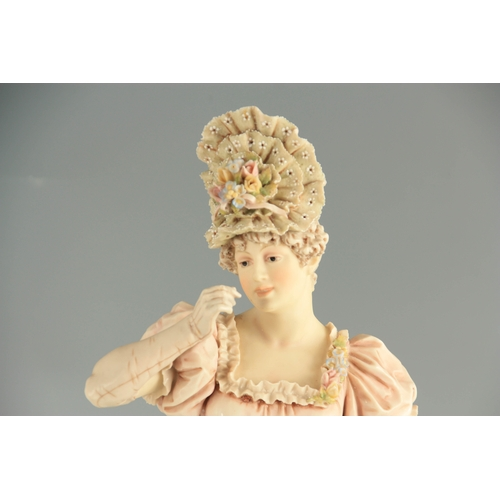 48 - A PAIR OF LATE 19TH CENTURY ROYAL DUX FIGURES of a Lady and a Gentleman mounted on naturalistic flow...