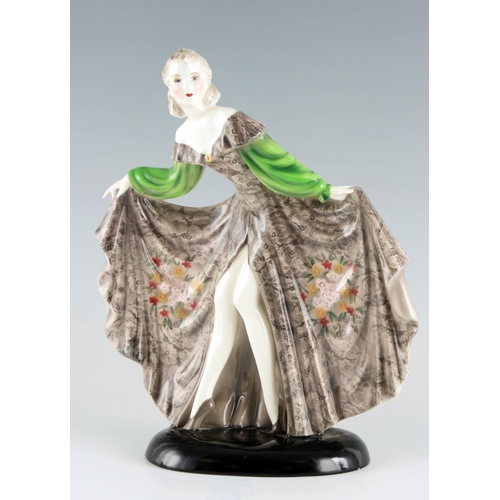 52 - A STYLISH GOLDSCHEIDER STANDING FIGURE OF A YOUNG LADY in an elaborate swept dress 32cm high 27cm wi...