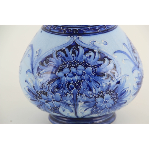 57 - A FLORIANWARE MOORCROFT SLENDER NECK BOTTLE VASE with stylised piped floral decoration - with printe...
