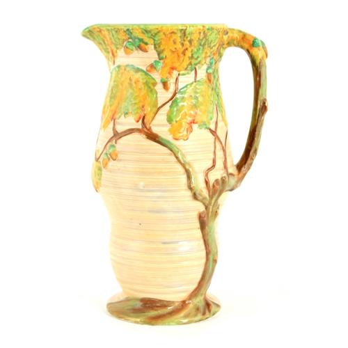 59 - A 1930's/40's CARLTON WARE LARGE JUG the ribbed bulbous body decorated in relief in the oak tree pat...