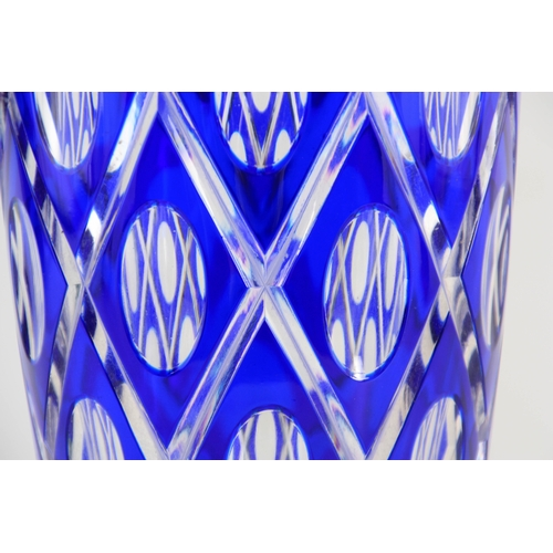 8 - A BOHEMIAN BLUE OVERLAY AND CLEAR TAPERING GLASS VASE with lozenge decoration to the body enclosing ...