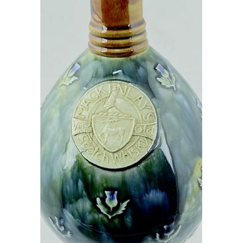 2 - Mackinlays Doulton Artware Whisky Jug. 8ins tall, tan top & handle. Mottled blue & green body artwar...