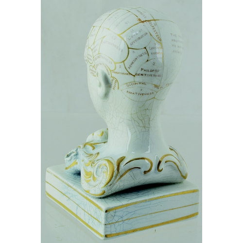 10 - PHRENOLOGIST HEAD INKWELL. 5.5ins tall, off white glaze with gold highlights. Various pats of the br...