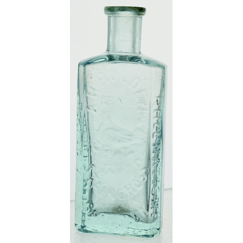 11 - Holdens Tommy Bottle. 4.3ins, ice blue glass, rectangular body, heavy, chamfered corners, delicate l...