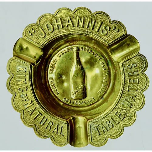"16 - Johannis Table Waters Ashtray. 4.6ins diam, brass, fancy curved edges,. Raised embossing "" JOHANNIS""..."