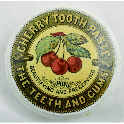 512 - CHERRY TOOTH PASTE POT LID. (APL p 143, 70) 3ins diam. Colourful pot lid with yellow ground & red ch...
