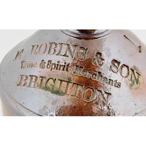 547 - BRIGHTON ONE GALLON FLAGON. 13.5ins tall. Very crude with lots of inmanufacture character! T.t, tan ...