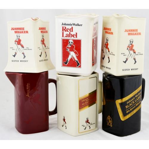 18A - MIXED JOHNNIE WALKER PUB JUG GROUP. An interesting variety of different Johnnie Walker water jugs. A...