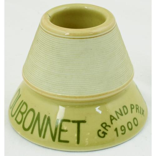 31 - DUBONNET 1900 MATCHSTRIKER. 3ins tall. Circular funnel shape matchstriker, central match well with s...