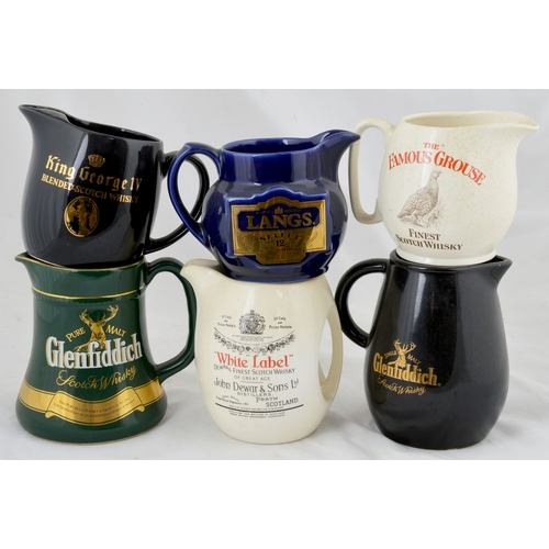 33A - MIXED WHISKY WATER JUG GROUP. A fine range of different whisky water jugs, all in very good conditio...