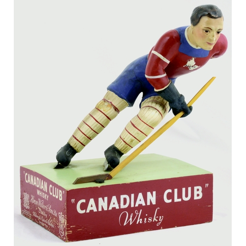 39 - CANADIAN CLUB WHISKY BACK BAR FIGURE. 9.5ins tall. CANADIAN CLUB/ WHISKY, ice hockey player on plint...