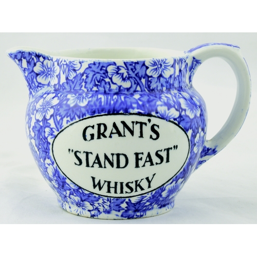 51 - GRANTS STAND FAST WHISKY WATER JUG. 3.5ins tall. Blue & white floral design & GRANTS/ STAND FAST/ WH...