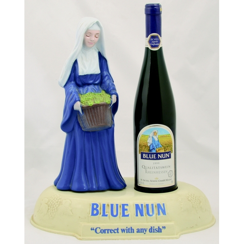 6 - BLUE NUN BACK BAR FIGURE. 14 by 13ins tall. Plastic display piece, classic Blue Nun figure & bottle ...