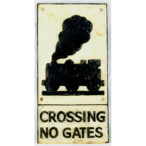 83 - CAST RAILWAY CROSSING SIGN. 23 by 11.25ins, black on off white background. Heavy cast railway crossi...