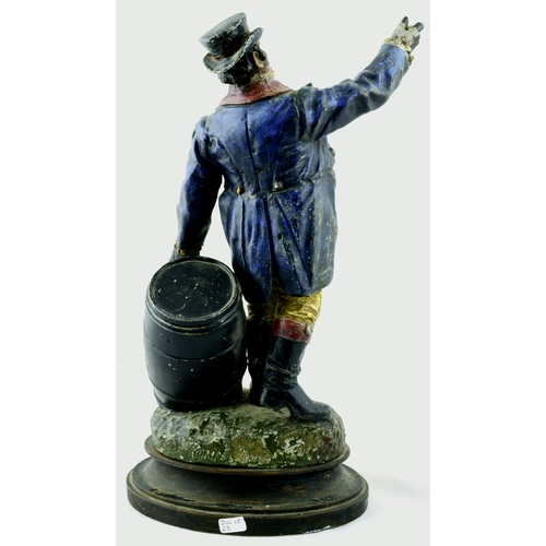 99 - MORTEGG ADVERTISING FIGURE. 13ins tall, heavy cast metal on wooden base. Vintage painted standing Jo...