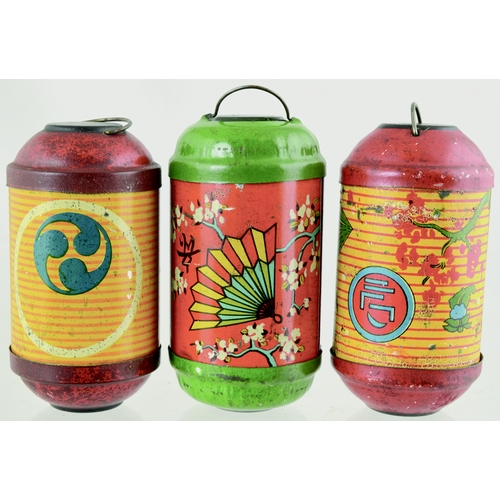 117 - CHINESE MINIATURE LANTERNS TRIO. 3.25ins tall. Chinese lantern shaped tins with various oriental ima...