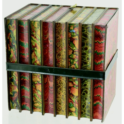 120 - HUNTLEY & PALMERS BOOKS TIN. 6.5 by 6ins. Tin formed as a set of books within buckled belt. HUNTLEY ...