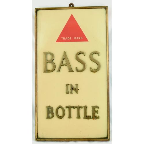 126 - BASS IN BOTTLE PUB INTERIOR ENAMEL. 20 by 11ins. Brass framed enamel sign BASS/ IN/ BOTTLE brass let...