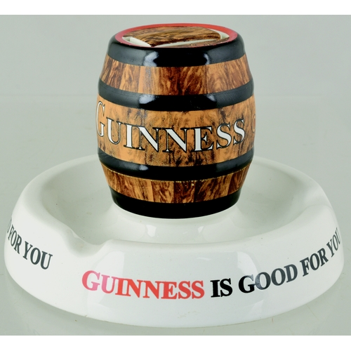 146 - GUINNESS ASHTRAY. 4ins tall. Circulare dish with barrel shaped matchbox holder naturalistically colo...