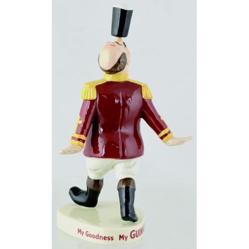 150 - GUINNESS RINGMASTER FIGURE. 7.5ins tall. Millenium Collectables multicoloured ringmaster balancing g...