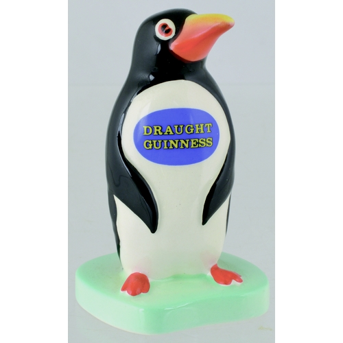 163 - GUINNESS PENGUIN FIGURE. 3.75ins tall. Coloured upright penguin with DRAUGHT/ GUINNESS across chest ...