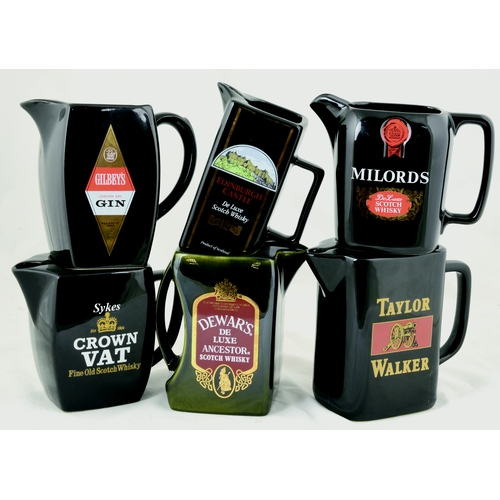 168 - PUB JUG GROUP.Tallest 6 ins, all black glazed bodies, various shapes & different coloured transfers ...