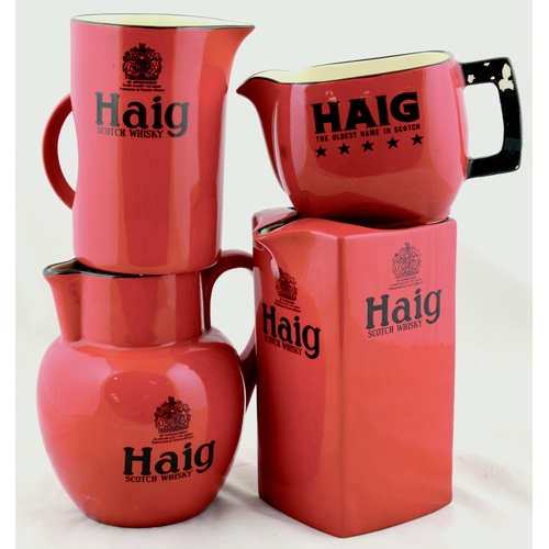 179 - HAIG WHISKY WATER JUGS GROUP. Tallest 7.5ins. Four variations of Haigs, red glaze, black transfers. ...