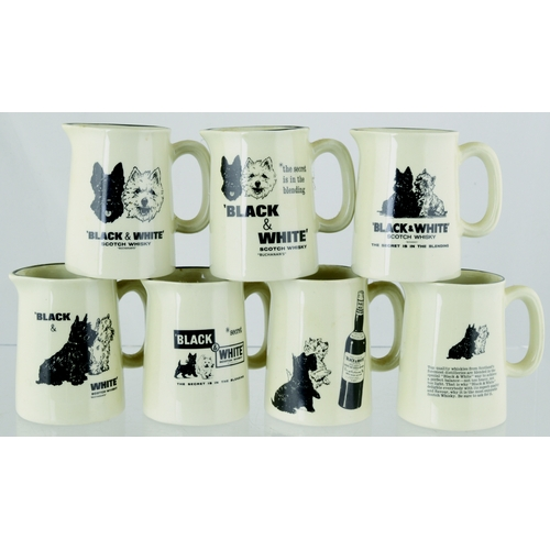 205 - BLACK & WHITE MINIATURE JUGS. 3ins tall. 7 variations of Black & White Whisky water jug, all with pi...