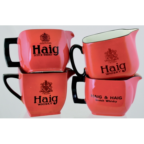 207 - HAIGS WHISKY WATER JUGS GROUP. 4 variations of Haig Whisky water jug. Red glaze with black transfers...