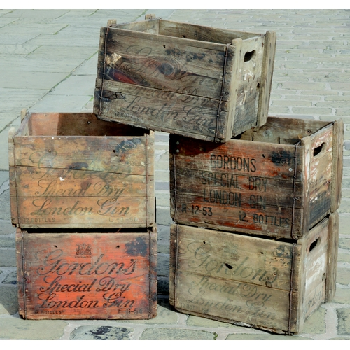 235 - GORDONS GIN CRATES GROUP. Largest 16 by 10.5ins. Five crates with wording for Gordons Special Dry Lo...