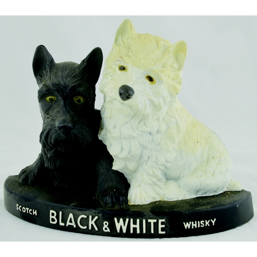 267 - BLACK & WHITE SCOTTIE DOGS BACK ABR FIGURE. 8ins tall. Rubberoid Scottie dogs on plinth SCOTCH BLACK...