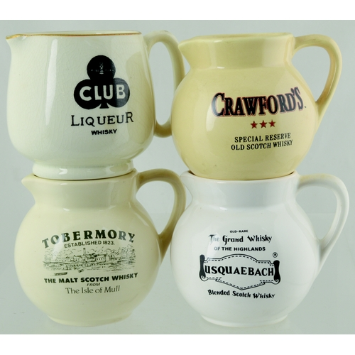 270 - MIXED PUB JUG GROUP. Tallest 3.25ins. Miniature water jugs, 4 variations, Inc. Crawfords, Tobermory ...