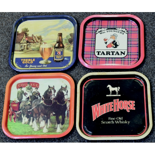 300 - BEER TRAYS GROUP. 13.5ins diam. Multi-coloured trays for beer & one for whisky. Generally good. (4) ...