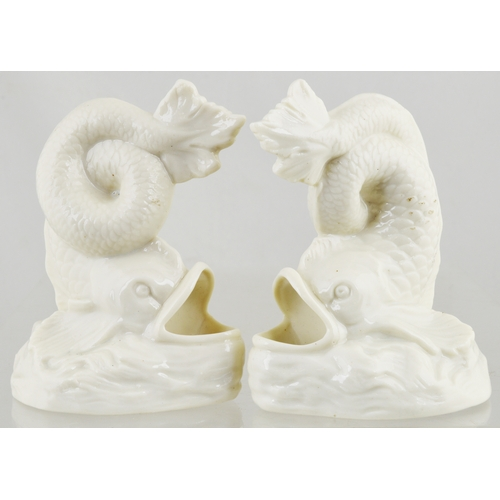 51 - PERRY & CO LONDON WHITE POTTERY FISH INKWELLS DUO. 4.5ins tall. White glaze, gaping mouth forms actu...