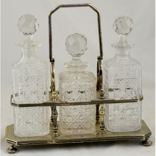 53 - DRINKS DECANTERS SET. 3 cut glass (whisky?) decanters set in decorative silver holder (marked). Good...